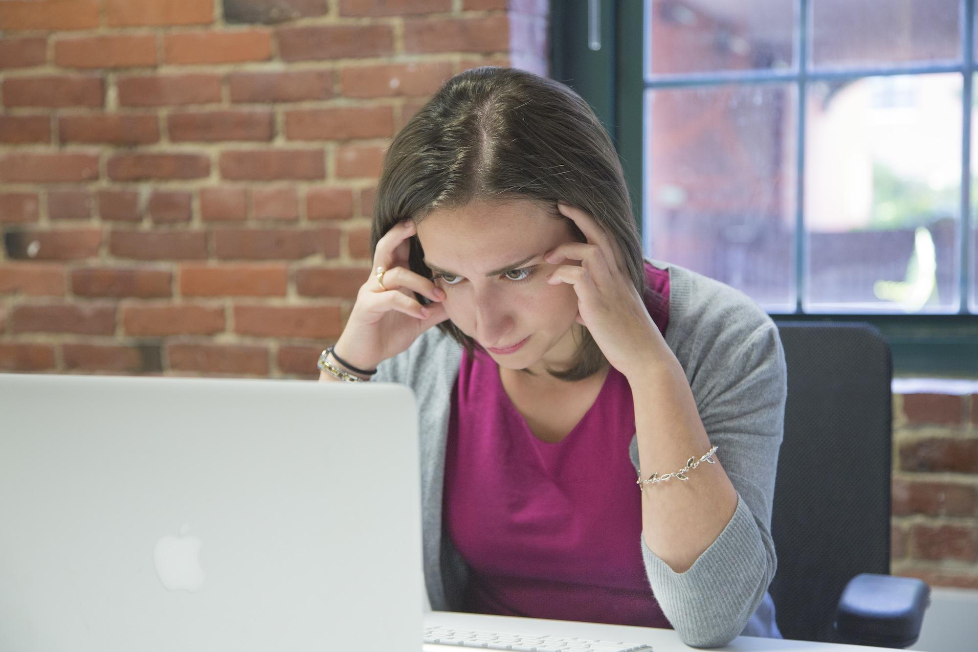 Woman staring at computer